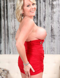 Plump older woman in a red dress and crotchless panties disrobes to masturbate