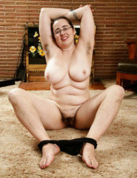 Mature fatty in glasses showing off hairy underarms and fleshy breasts