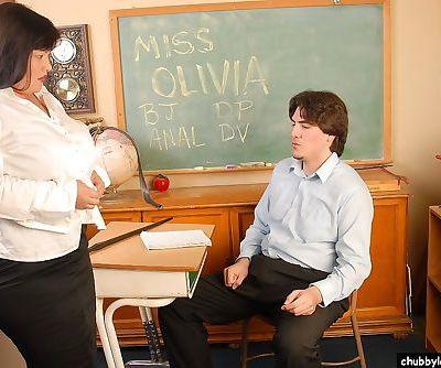 Mature BBW schoolteacher Olivia giving a blowjob in classroom
