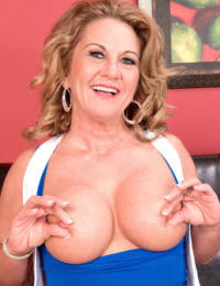 Mature woman Cali Houston uncovers her big boobs prior to masturbating