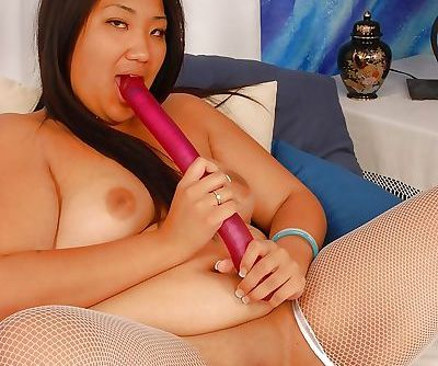 Asian plumper in lingerie and stockings stripping and toying her cunt