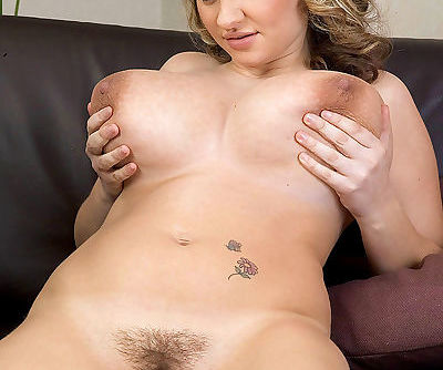 BBW solo girl Kelly Kay fondly frees her huge saggy boobs while undressing