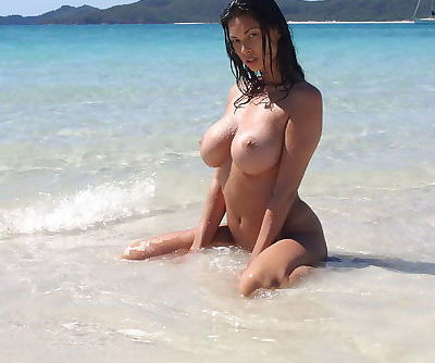 Big breasted Tera Patrick tanning her naked hot body on the beach