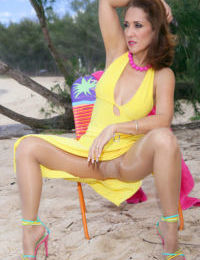 Long legged mature hottie Roni flashing great tits and ass on the beach