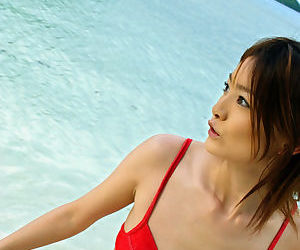 Svelte asian hottie with neat ass Ray Ito slipping off her red bikini