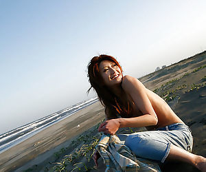 Lovely asian babe Yu Satome uncovering her big tits outdoor