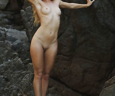 Tiny titted hot blonde sheds yellow bikini to skinny dip in the rock pool