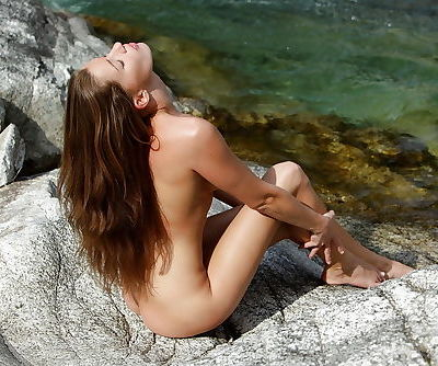 Naughty babe pornstar spread her legs to show her clit outdoor