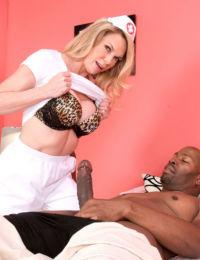 Hot older nurse Alexa Rae helps herself to some black cock at work