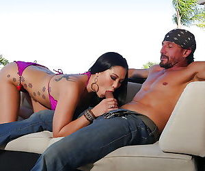 Tattooed Asian pornstar London Keyes giving big cock a blowjob in bikini