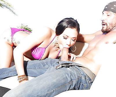 Tattooed Asian pornstar London Keyes giving big cock a blowjob in bikini