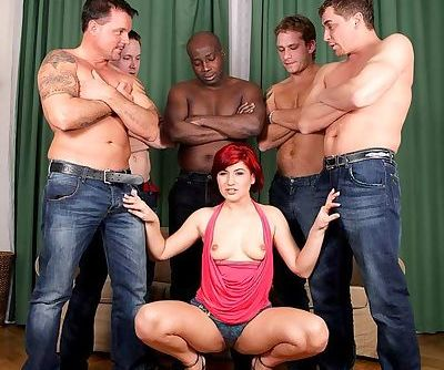 Redhead pornstar Lucy Bell has her pussy double fucked during a gangbang