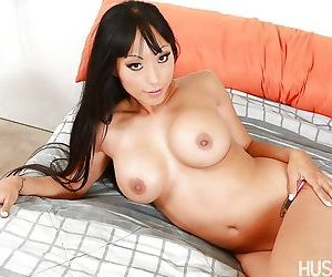 Asian babe Gaia frees big MILF pornstar tits and shaved pussy
