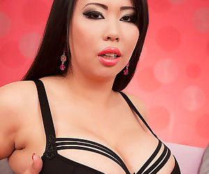Hot Asian MILF Tigerr Benson releases her huge tits from black bra