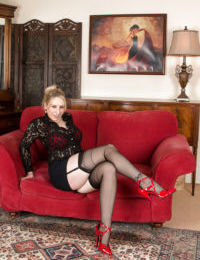 Leggy blonde lady Mel Harper striking sexy poses in stockings and garters