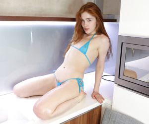 Hot redhead Jia Lissa in skimpy bikini strips to spread pussy on her knees