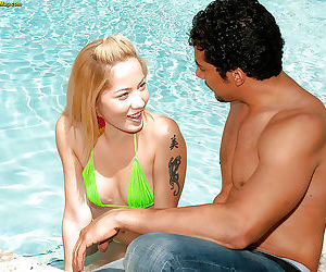 Amateur Asian cutie Layla Leoni kissing a sexy guy outdoor by the pool