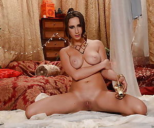 Teen pornstar Ashley Adams looks a doll in harem outfit with finger in anus