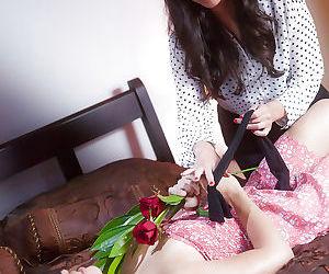 Asian pornstar Kobe Lee seducing a blindfolded Sara Luvv for lesbian sex