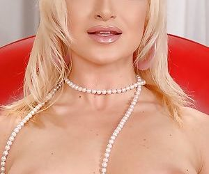 Blonde beauty Angela undressing for spreading of pink vagina