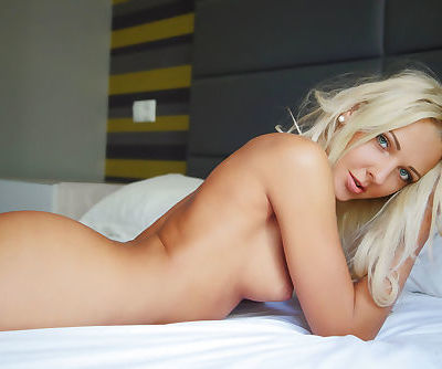 Hot blonde Maya wakes up from a snooze and proceeds to finger her pussy