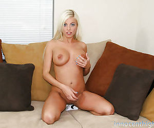 Blonde babe Britney shows her big tits and spreading cute pussy