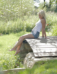 Sweet blonde Anneli in short skirt spreading wide open outdoor to show pussy