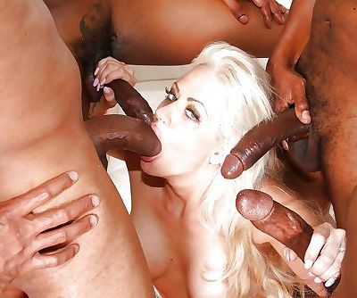 Busty blonde slut Holly Heart gangbanged by black men with huge dicks