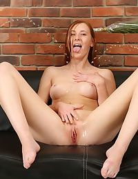 Young redhead Linda Sweet plays pissing games and gets DP in kinky threesome