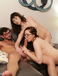 Tiny titted brunette & friend in glasses enjoy hard cock in their hairy pussy