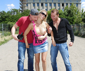 Blonde Euro pornstar Julia Pink giving outdoor blowjobs in MMF threesome