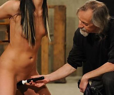 Brunette female is restrained before having her pussy stimulated for her