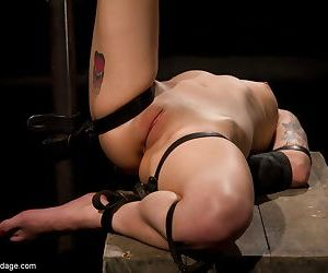 Asian female with a bald pussy is left gagged and restrained with 1 leg in air