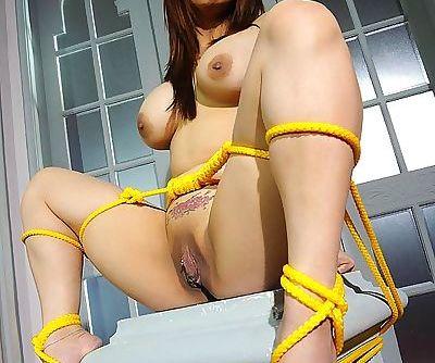 Busty rope bound Asian BDSM model Tigerr Benson taking a pee