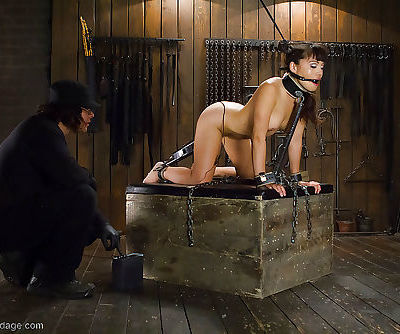 Asian bondage babe Milcah Halili is covered in hot wax while restrained