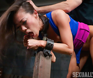 Asian chick Kalina Ryu is restrained by the wrists and made to suck cock