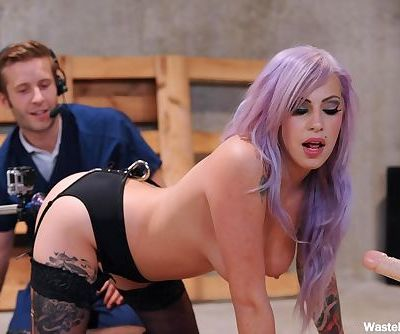 Hot emo model in black stockings is guided thru an anal fuck by a sex machine