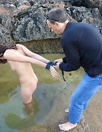 Naked teen is ball gagged and restrained before being submersed in cold water
