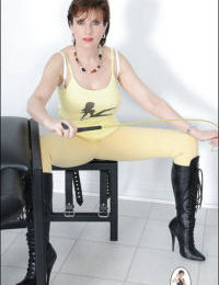 Stunning mature lady posing in black boots and skin-tight jeans