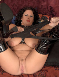 Middle-aged plumper Slone Ryder toys her twat in stripper boots
