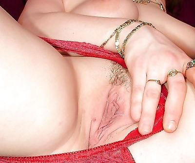 Pale skinned milf Nia opens her banged hairy pussy and shows big tits