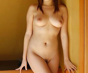 Asian solo unshaded Hitomi Kitagawa proudly displays the brush obese natural booobs