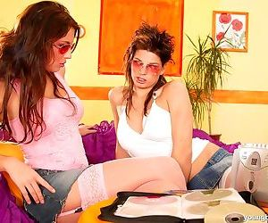 Young lesbians hookup for sex in sunglasses and stockings