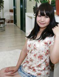 Oriental amateur devoid of strings beneath her miniskirt exposing her skinhead gash