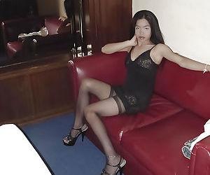Asian brunette Fon exposing hairy pussy in lingerie and stockings
