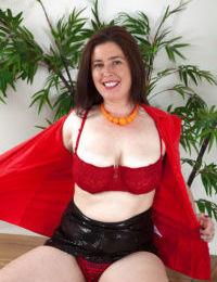 Mature secretary Janey hiking black skirt at work for upskirt panty viewing