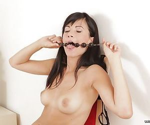 Brunette female Lauren inserting anal beads int shaved vagina