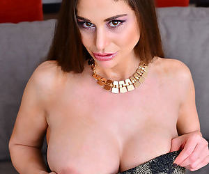Hot brunette with huge tits fingering shaved pussy wearing stockings and heels