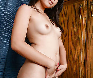 Sassy asian amateur with small tits undressing and spreading her lips