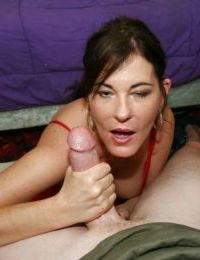 Lusty mature brunette gets a large facial cumshot after handjob